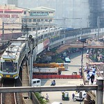 Manila LRTS BN (BN Constructions Ferroviaires et M�talliques) 1000 Series 1st Generation Unit #1049 approaching Edsa Station: Manila Light Rail Transit System (LRTS) Line 1